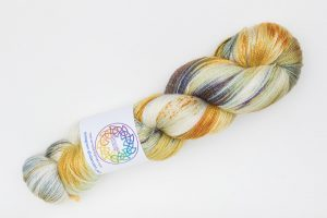 BFL-Silk Fine Lace-weight cream, dark blue and rust speckles
